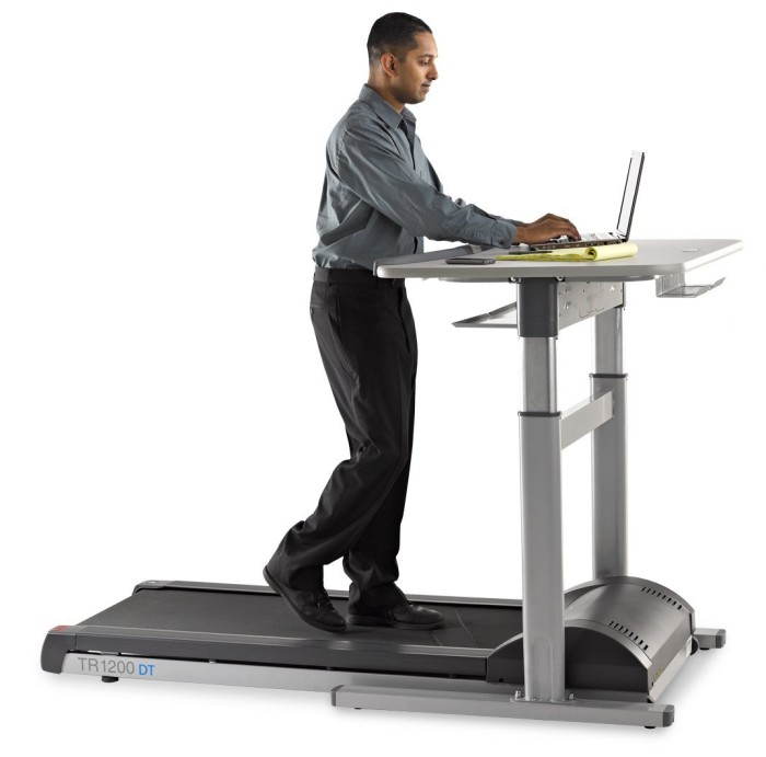 The DT7 treadmill desk features an electronic desk height adjustment system