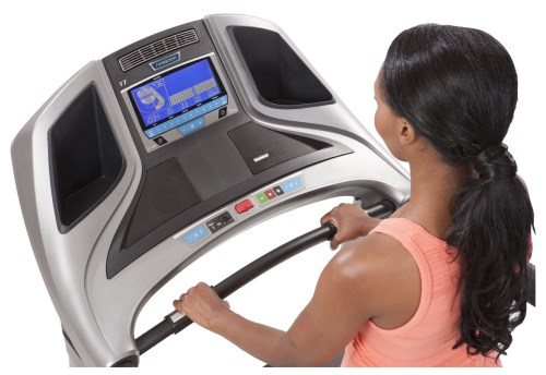 The Elite T7 treadmill features an extra-wide blue LCD display