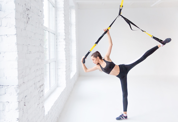 Suspension trainers can be used to stretch your muscles, but require a high fixing point