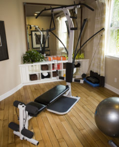 Compact home gym machine using cable pulleys and Power Rods for resistance