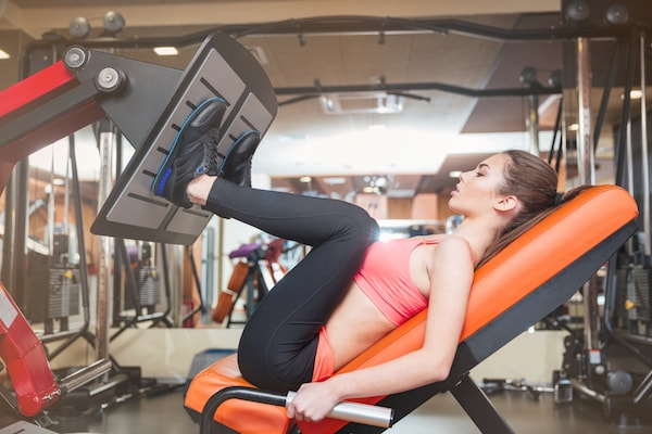 Leverage leg press machines can help strengthen your quads, calves, glutes, and hamstrings