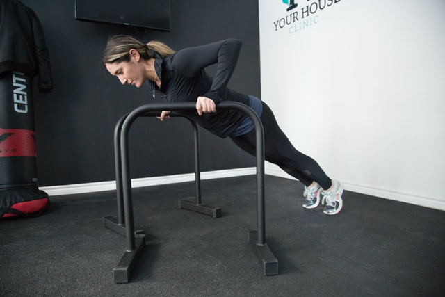 Woman using handles for incline pushups