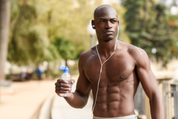 Muscular man with water bottle in hand